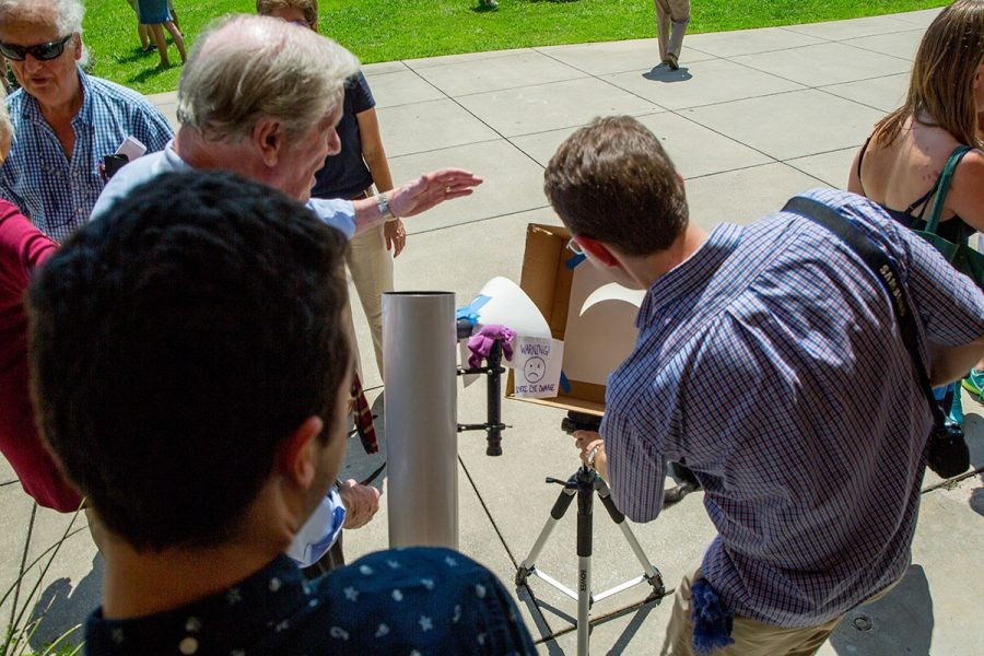 President Thrasher at the solar eclipse viewing part at the Union Green Aug. 21, 2017. (FSU Photography Services)