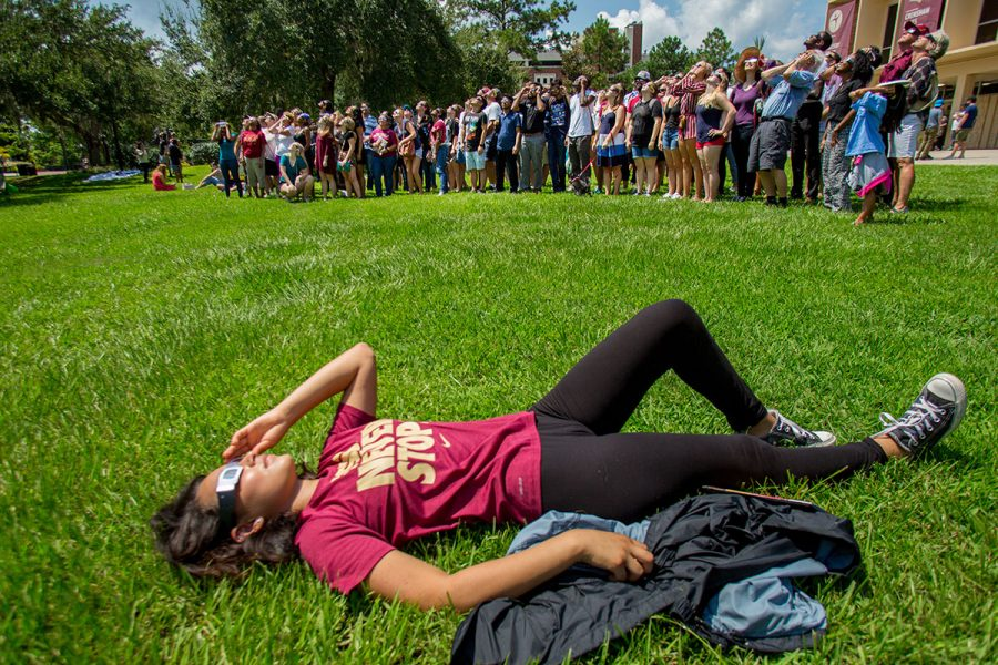 Students, faculty and staff view the solar eclipse at the Union Green Aug. 21, 2017. (FSU Photography Services)