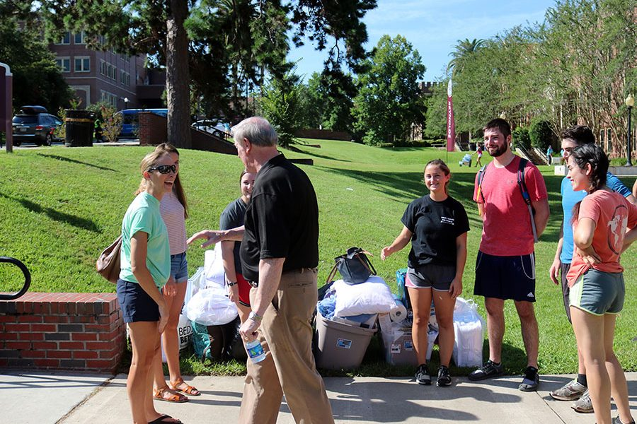 President Thrasher greets students and parents at residence halls move-in Aug. 23, 2017. (Bayard Stern)