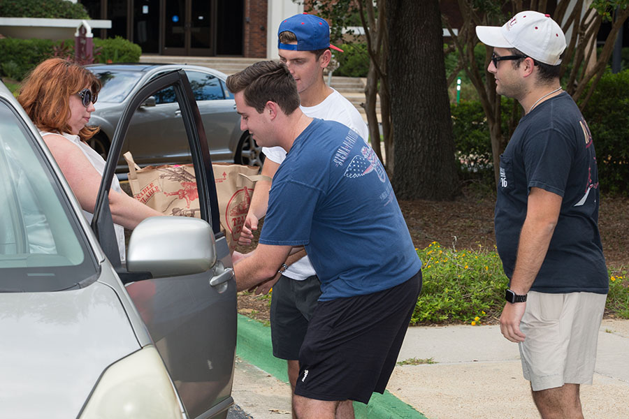FSU staff members and volunteers collect donations at the Hurricane Irma relief drive Thursday, Sept. 14, at the Donald L. Tucker Civic Center.
