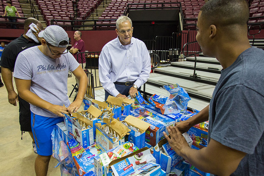 SUS Chancellor Marshall Criser III helps make care packages with FSU students. (FSU Photography Services)