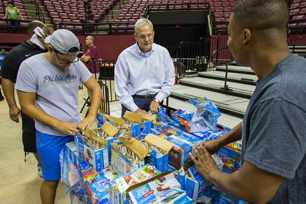 SUS Chancellor Marshall Criser III helps make care packages with FSU students.
