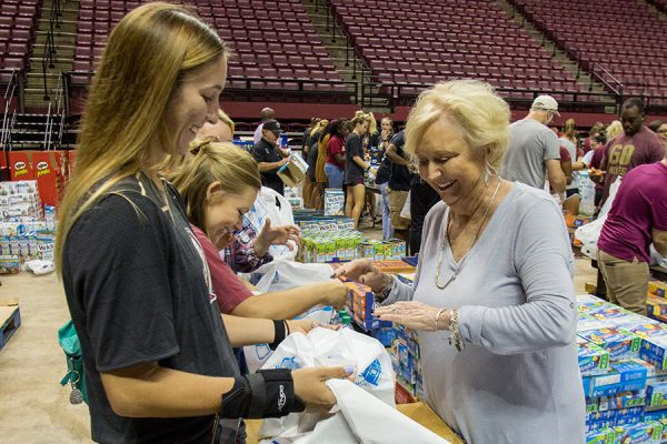 Mrs. Jean Thrasher helps make care packages with FSU students. (FSU Photography Services)