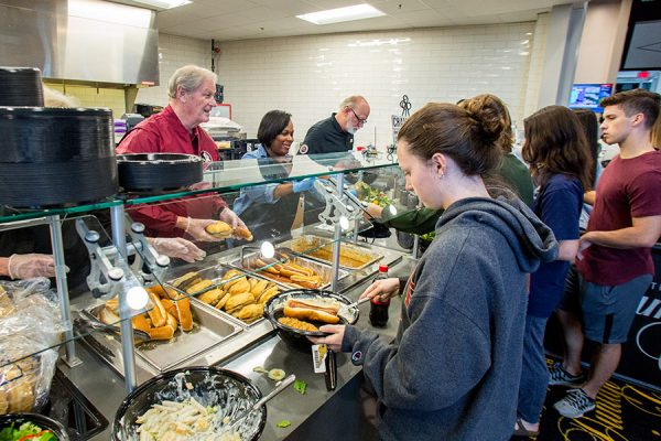 President Thrasher serves meals to grateful students following Hurricane Irma.