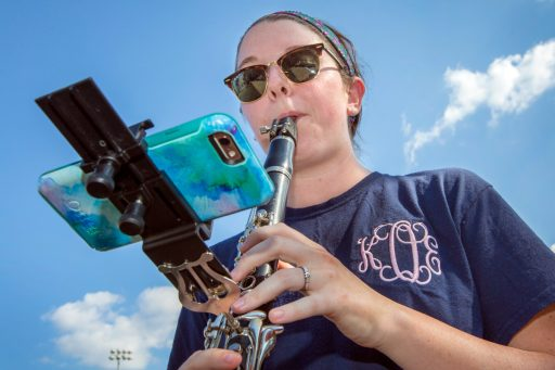 Katie Olney uses the eFlip mount on her clarinet during practice.