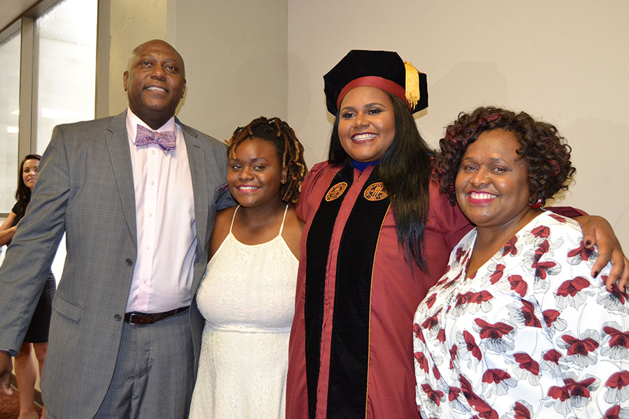 Lataisia Jones, second from right, with her parents and sister at FSU summer commencement Aug. 5, 2017.