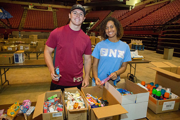 Conor McClain and Bryana Beckford were both happy to donate their time this morning to help South Floridians.
