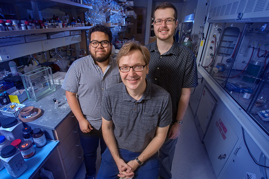 Professor Igor Alabugin with graduate students Gabriel dos Passos Gomes and Trevor Harris have developed a way to make a critical chemical reaction more effective and safe for work in biological systems. (FSU Photography Services)