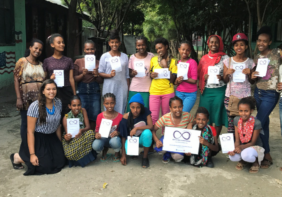 Jessica Bachansingh (first row, left) spent time in Ethiopia over the summer teaching the sewing curriculum to students and teachers involved in Girls for Confidence.
