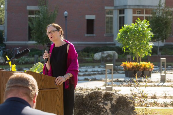 Laura Osteen, director of the Center for Leadership & Social Change, speaks at the grand opening of the FSU Labyrinth, located on West Call Street between the College of Medicine and the Psychology Building, on Thursday, Nov. 2. (FSU Photography Services)