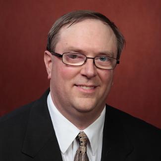 Professor of Physics Todd Adams