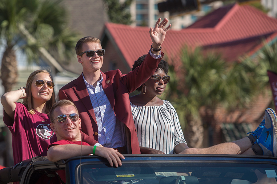 SGA President Kyle Hill (center) rides in the Florida State University 2017 Homecoming Parade. (FSU Photography Services)