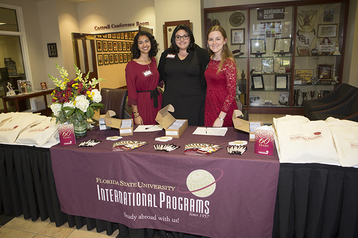 International Programs 60th Anniversary Dinner. (From left to right are Yasmine Chami, Dana Leger, and Katherine Thornton- International Programs student recruiters.) (Photo: FSU Photography Services)
