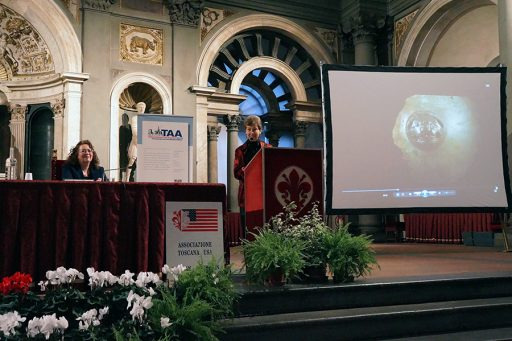 Nancy de Grummond accepts the award of merit from the Tuscan American Association in the Salone dei Cinquecento (Room of the 500) at the town hall of Florence, the Palazzo Vecchio. Andrea Davis, president of the association, looks on.