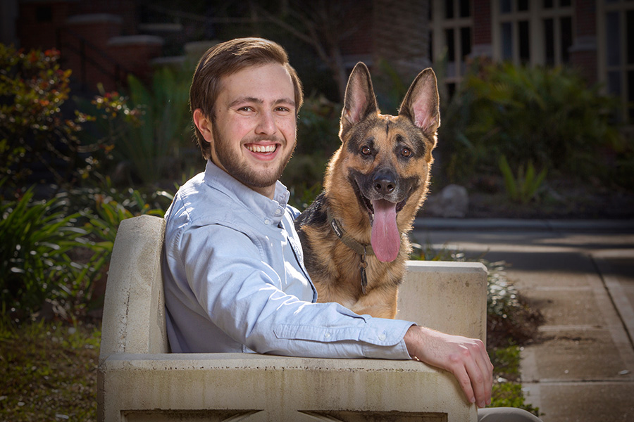 Hunter Carlock, a junior computer science student, and his dog, Barli, featured in a 2017 Student Stars feature.