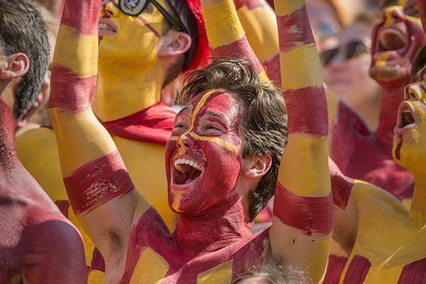 Students painted in garnet and gold cheer on the Seminoles during their game against NC State.