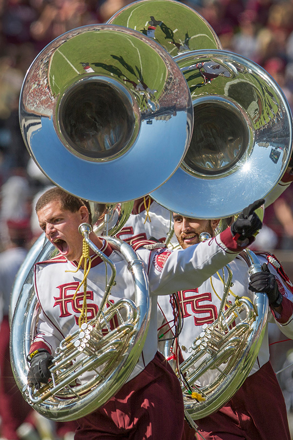 The Marching Chiefs' tuba squad run into position during their Homecoming performance.
