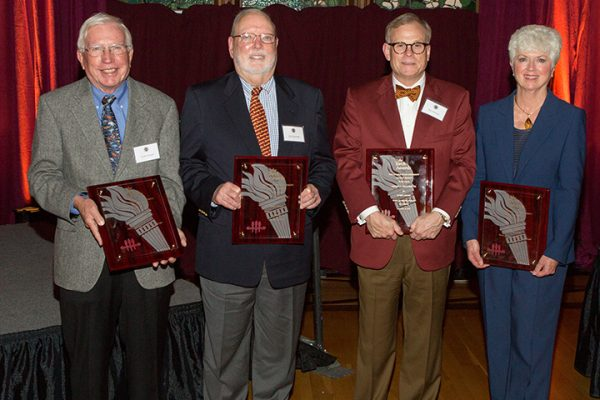 Four members of the FSU family were honored with Torch Awards on Monday, Dec. 4. From left: Kirby Kemper (Vires), Guy Spearman (Mores), Ash Williams (Mores) and Jan Moran (Vires). (Photo: Photography Services)