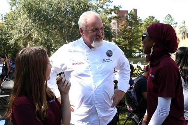 Isa Colli, vice chair of the Power of WE, FSU culinary ambassador Art Smith and Inam Sakinah, founding chair of Power of WE chat at the Longest Table Event. (Photo: FSU Social Media)
