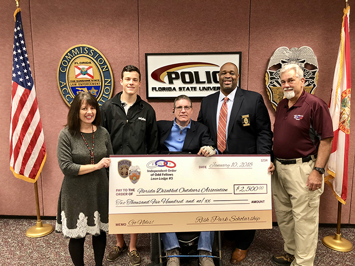 From left to right: Laurie LoRe-Gussak, Florida Disabled Outdoor Association; John Wilcox, UoC President; J.R. Harding, instructional specialist; Chief of FSUPD David Perry; Mike Rodes, retired FSUPD officer (Photo: FSUPD)