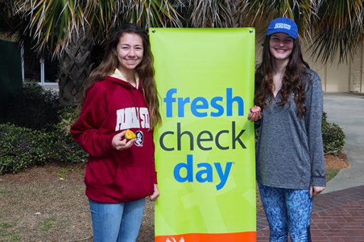 Freshmen Melanie Porter (left) and Darcy Farwell (right) enjoyed the festivities and learning about mental health on campus. (Photo: University Communications)
