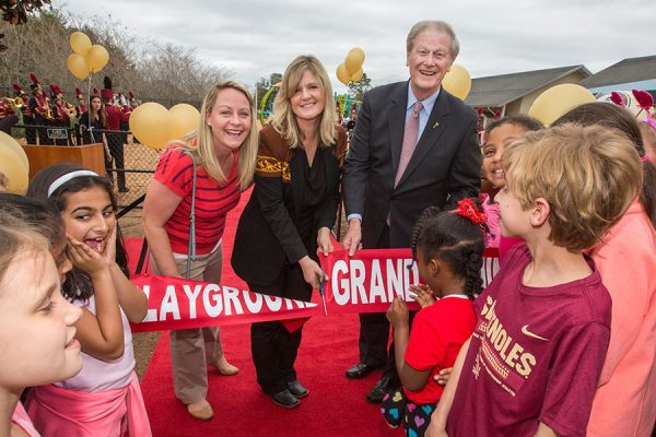FSUS Executive Director Stacy Chambers and President John Thrasher with parents and students at the new playground's ribbon-cutting Feb. 14. (FSU Photography Services)