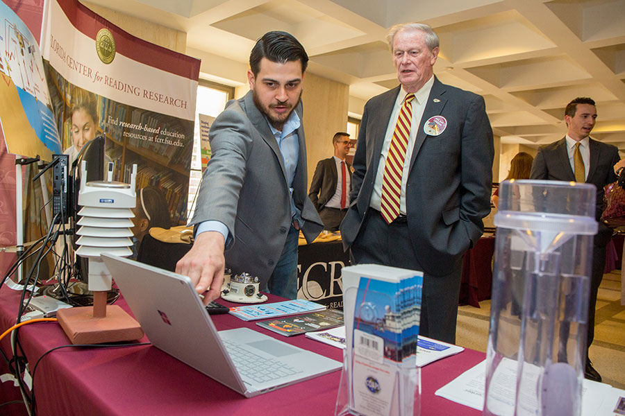 President John Thrasher visits information tables during FSU Day at the Capitol Feb. 6, 2018. (FSU Photography Services)