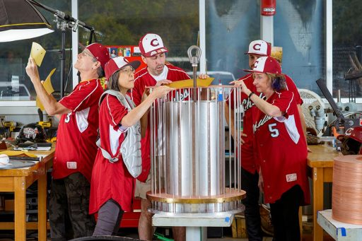 National MagLab Chief Scientist Laura Greene, far right, and other MagLab staffers donned baseball uniforms from Chiles High School to prove the point that science is team sport. They are pictured here building a magnet coil for one of the MagLab's dozens of magnets.