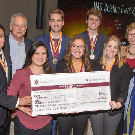 Members of the DriGo team: Jose Miranda (far left), Brianna Yeung (left center), Megan Simpson (center), Claire Kelly (right center), Susan Fiorito, Director, Jim Moran School of Entrepreneurship (far right) BACK ROW: Mark Scott (far left), Hunter Wheeler (left center), Billy Courson (right center), Wendy Plant, Jim Moran School of Entrepreneurship (far right)