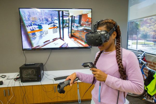 Student using the virtual reality equipment available at the new Innovation Hub in the Shores Building. (Photo: UC Photography Services)