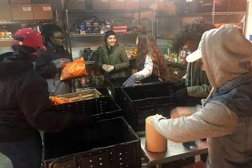 Alice Mathieu, Tamika Jones, Saphicher Gonzales, Katherine Ramirez, Victoria Decius, Yandry Varela. This morning our team worked on organizing the YMCA food pantry of Western North Carolina to prep food for distribution throughout the community of Asheville, North Carolina.