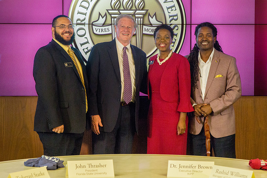 (From left to right) Tadarrayl Starke, the director of CARE, FSU President John Thrasher, KIPP Executive Director Jennifer Brown and Rashid Williams, an FSU alumnus and KIPP manager of college placement and a partnership signing with KIPP Jacksonville. (Photo: FSU Photography Services)