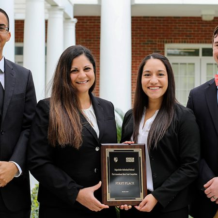 Third-year law students Jenna VonSee and Brenda Czekanski won a national moot court competition March 23-24. They were coached by College of Law alumni Jonathan Martin (left) and Ian Waldick (right),