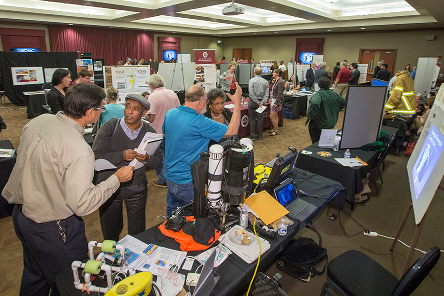 Attendees filter through the dozens of research, technology, arts and business exhibits on display throughout the Turnbull Conference Center.