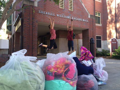 Two volunteers jump in excitement at the large number of donations collected from a residence hall. (Photo: FSU Sustainable Campus)