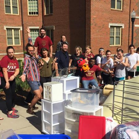 Volunteers from last year's Chuck It For Charity event stand by a collection of items from one of the residence halls. (Photo: FSU Sustainable Campus)