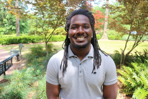 """""""Before just throwing something out, stop and think about if someone else could use it,"""" said Unconquered Scholar Abdullah Derosier. """"It doesn't take a lot of time but it could make a huge difference."""" (Photo: University Communications)"""