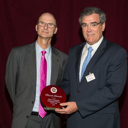Vice President for Research Gary Ostrander and Danfoss Turbocor Compressors President Ricardo Schneider, winner of the FSU Office of Research Community Partner of the Year Award April 3. (FSU Photography Services)