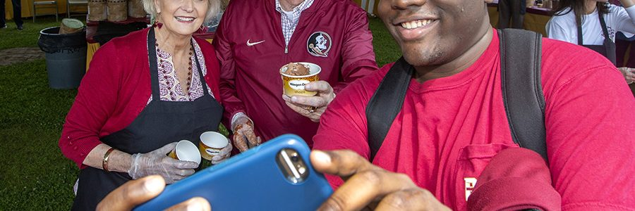 President Thrasher and his wife Jean take a selfie with an excited student during the President's Ice Cream Social. (Photo: UC Photography Services)