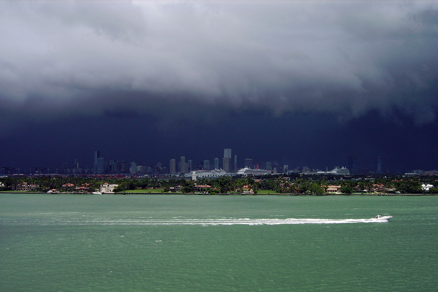 A summer storm gathers over Miami. Misra found that large urban areas are experiencing shorter, more intense wet seasons than rural or less developed areas.