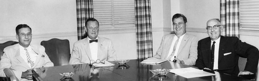 This is a photograph of Charles Davis, Robert Manning Strozier, R. Ross Oglesby, and Rod Shaw seated around a conference table.