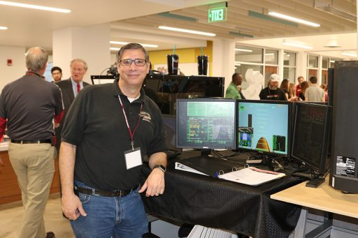 FSU Ph.D. student and Florida State University School teacher, Peter Carafano won Best in Show for Innovation for his space flight simulator at DIGITECH. (Photo: University Communications)