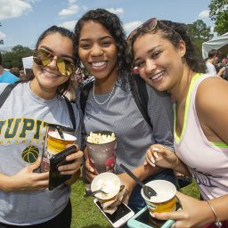 (From left) Alma Herrera, Asia Warren and Tiara McKinney enjoyed their first Ice Cream Social. (Photo: UC Photography Services)