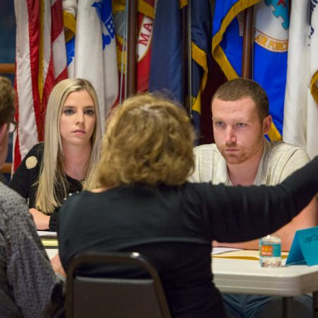 FSU law students Chandler McCoy and Joe Harrington listen to veterans and their families at the Veterans Legal Clinic held at American Legion Post #13 in Tallahassee. (FSU Photography Services)