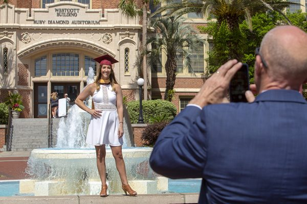 FSU Graduates pose for photos in front of Westcott before the 2018 commencement ceremonies.