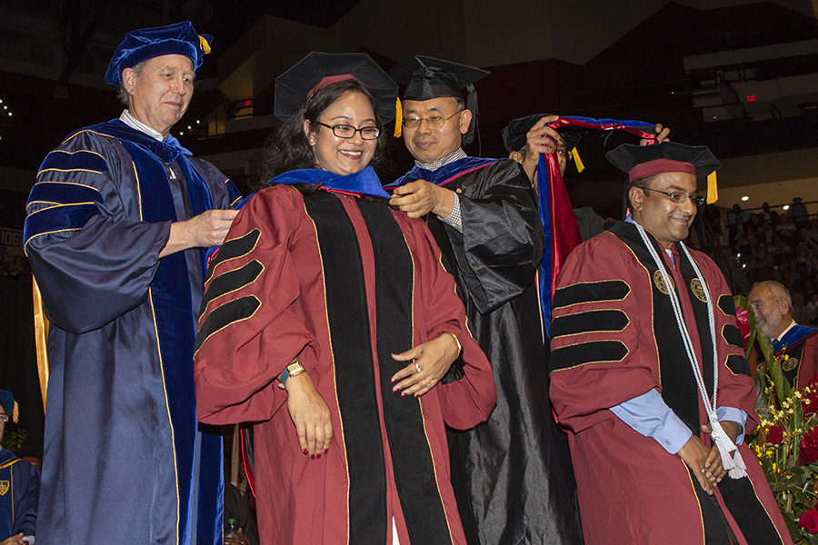 Chaity Banerjee Mukherjee and Tathagata Mukherjee, wife and husband, both receive their doctorate in computer science at the FSU Spring Commencement 2018 Friday afternoon ceremony. (FSU Photography Services)