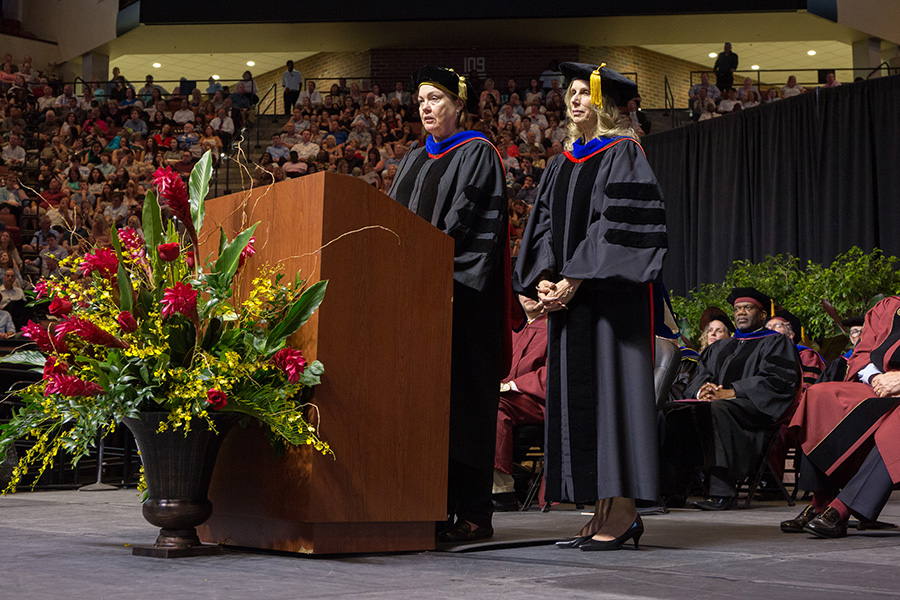 Provost Sally McRorie recognizes Pamela Perrewé, professor of management in the College of Business, as the Robert O. Lawton Distinguished Professor during the FSU Spring Commencement 2018 Friday night ceremony. (FSU Photography Services)