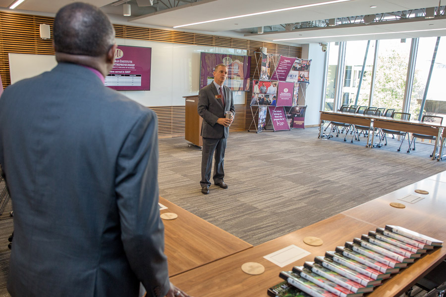 Mike Campbell, director of North Florida Operations for the Jim Moran Institute for Global Entrepreneurship, greets visitors during an open house on May 1, 2018. (FSU Photography Services)