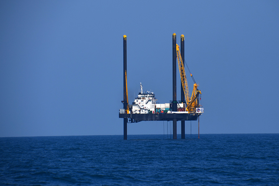 The core containing the first signs of life after the impact that wiped out the dinosaurs 66 million years ago was recovered from the crater by a 2016 scientific drilling mission conducted from the Lift Boat Myrtle (pictured here), a boat raised above the seafloor by three legs. (Credit: Chris Lowery, The University of Texas at Austin.)
