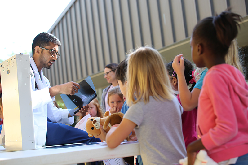 First-year med students at the FSU College of Medicine host a teddy bear clinic at Killearn Lakes Elementary School to help kids get more comfortable around doctors and medical equipment.